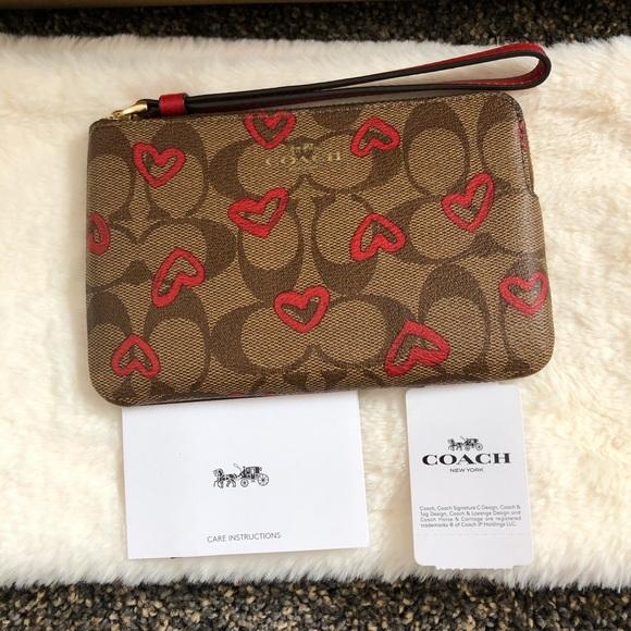 Coach Handbags - ❌Sold❌🔥Corner Zip Wristlet With Hearts Print